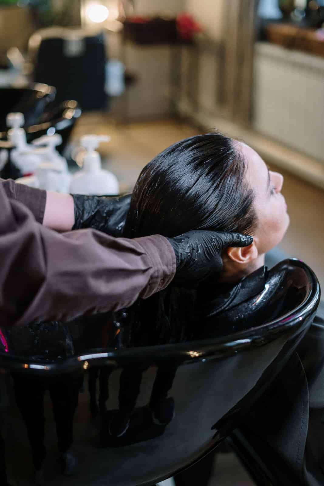 Canva Woman Having Her Hair Rinse 1