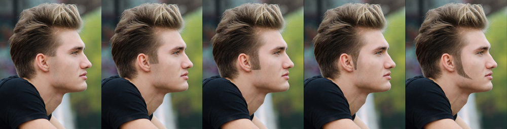 Profile  shot of attractive blond young man in city