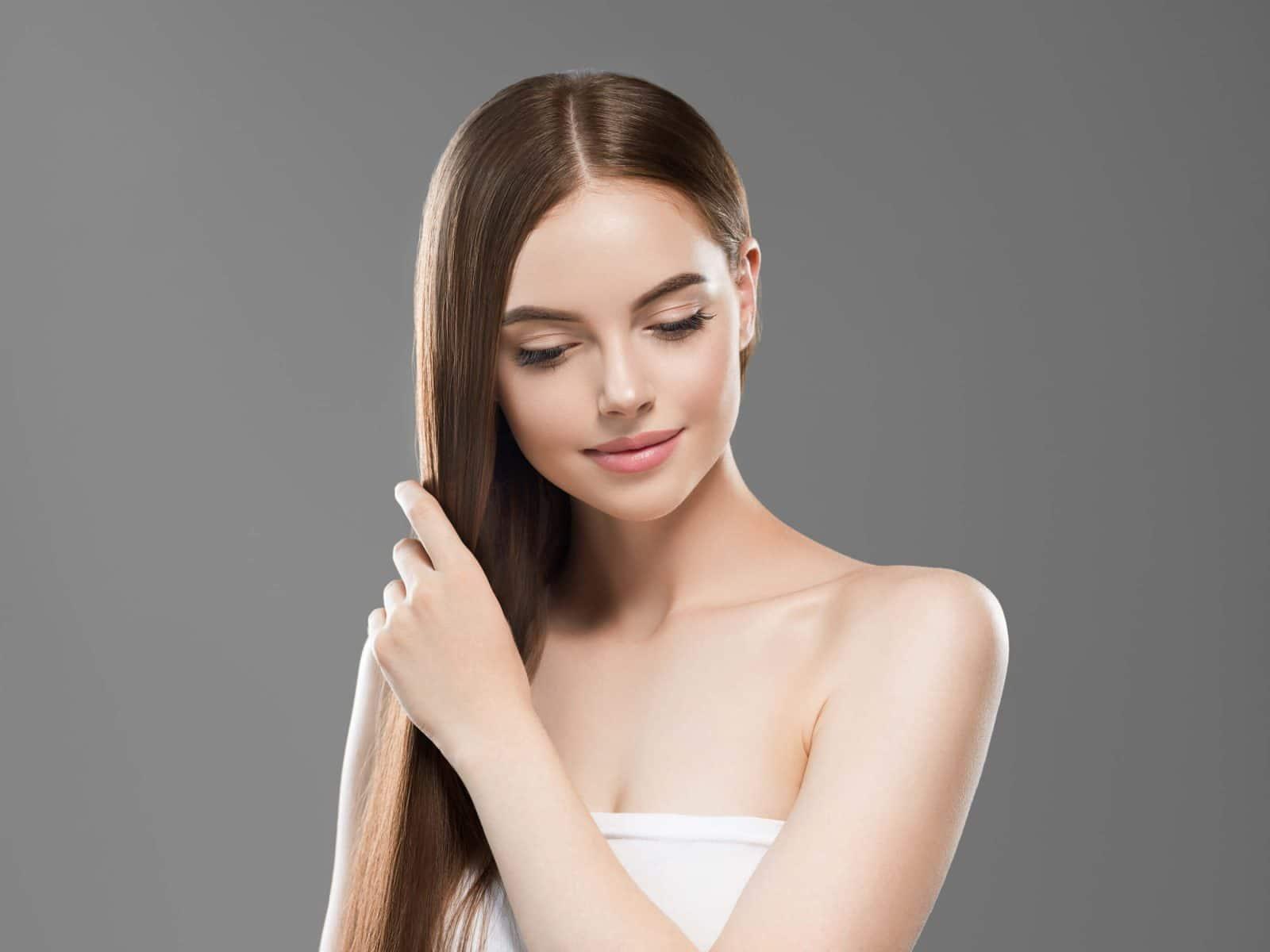 beautiful long hair brunette woman with beauty hai CKT583Y 1